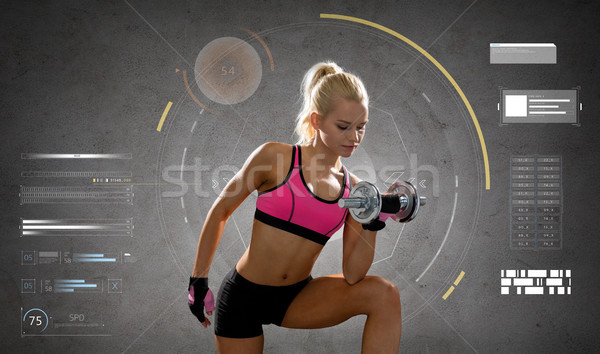 happy young sporty woman exercising with dumbbell Stock photo © dolgachov