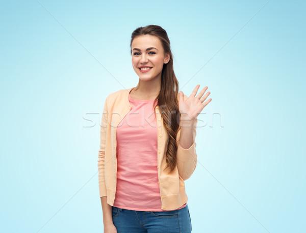 Feliz sorridente mulher jovem mão branco Foto stock © dolgachov