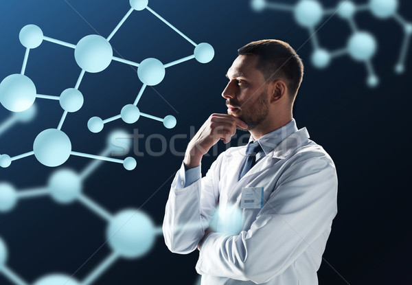 doctor or scientist in white coat with molecules Stock photo © dolgachov