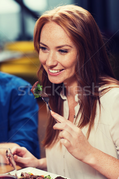 happy woman having dinner at restaurant Stock photo © dolgachov