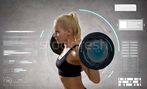 young sporty woman exercising with barbell Stock photo © dolgachov