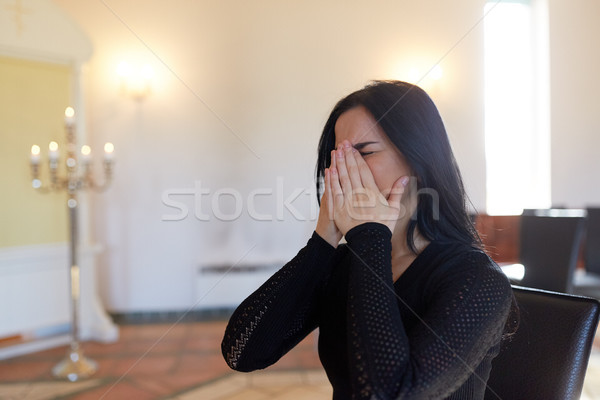 unhappy crying woman at funeral in church Stock photo © dolgachov