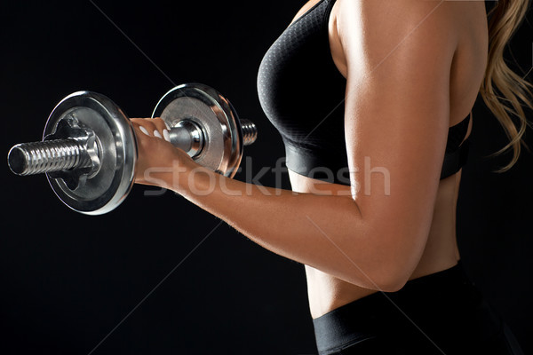 close up of sporty woman exercising with dumbbell Stock photo © dolgachov
