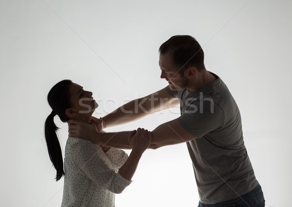 Coppia lotta uomo donna violenza domestica persone Foto d'archivio © dolgachov
