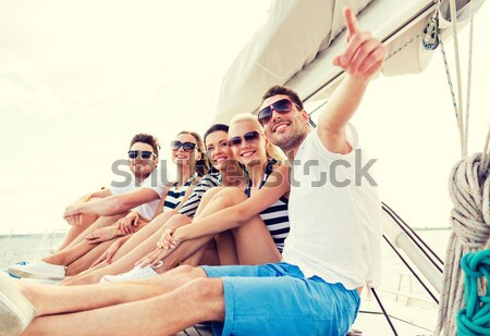 happy hippie friends at minivan car in africa Stock photo © dolgachov