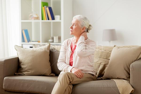 Kıdemli kadın boyun ağrısı ev Stok fotoğraf © dolgachov