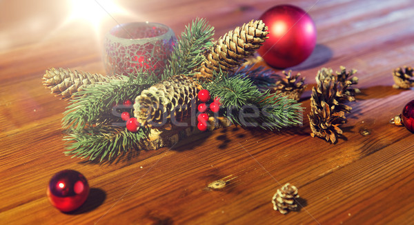 christmas fir branch decoration and candle lantern Stock photo © dolgachov