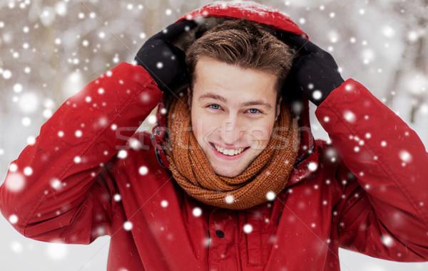 happy man in winter jacket with hood outdoors Stock photo © dolgachov