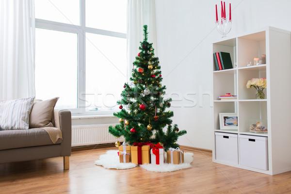 искусственный рождественская елка представляет домой праздников интерьер Сток-фото © dolgachov