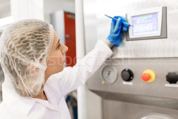 woman programming computer at ice cream factory Stock photo © dolgachov