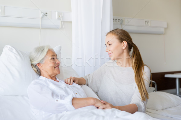 daughter visiting senior mother at hospital Stock photo © dolgachov