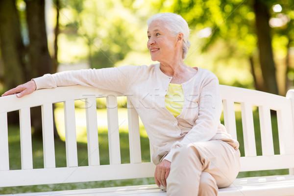 Boldog idős nő ül pad nyár Stock fotó © dolgachov