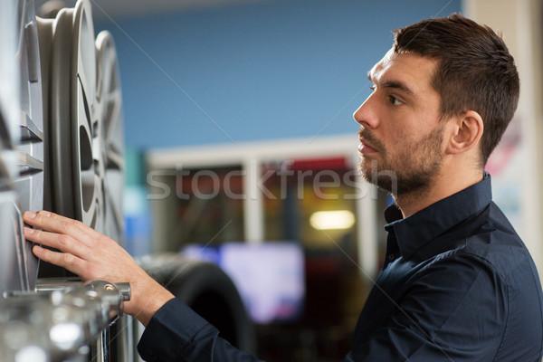 male customer choosing wheel rims at car service Stock photo © dolgachov