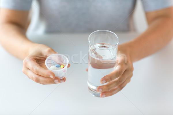 Ręce pigułki szkła wody muzyka Zdjęcia stock © dolgachov
