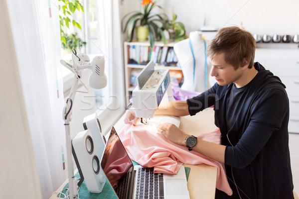 fashion designer with sewing machine working Stock photo © dolgachov