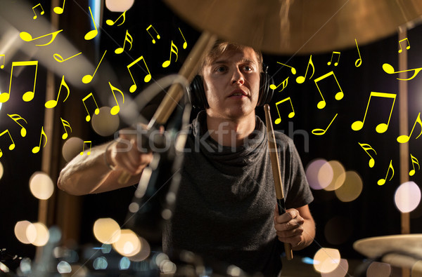 musician in headphones playing drum kit at concert Stock photo © dolgachov