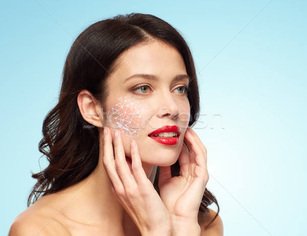 beautiful woman with low poly hologram on skin Stock photo © dolgachov