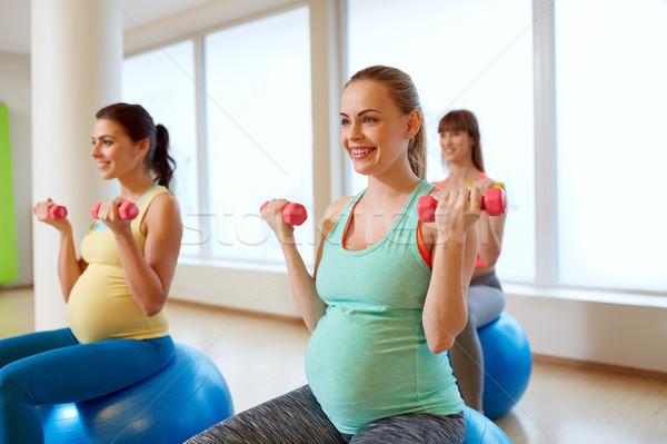 pregnant women training with exercise balls in gym Stock photo © dolgachov