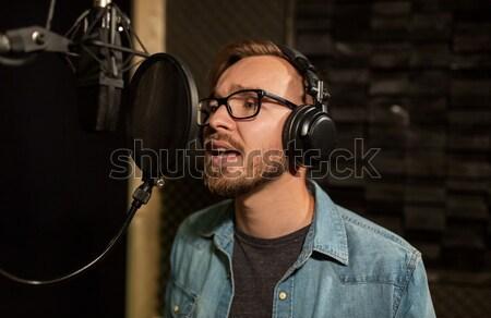 close up of creative man working at night office Stock photo © dolgachov