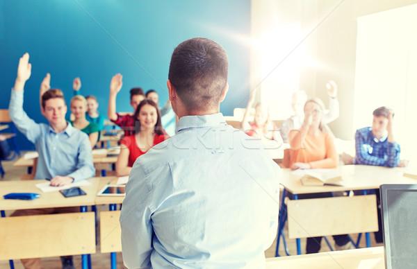 group of high school students and teacher Stock photo © dolgachov