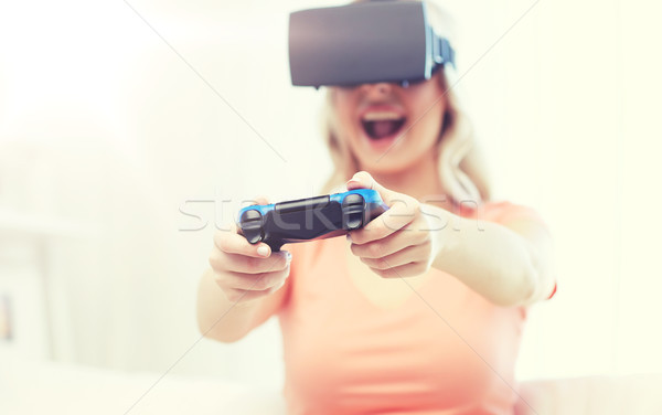 woman in virtual reality headset with controller Stock photo © dolgachov