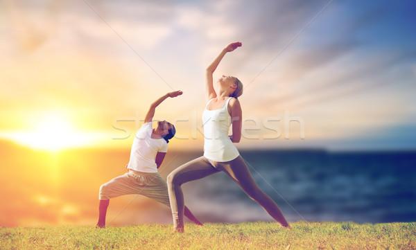çift yoga savaşçı poz açık havada Stok fotoğraf © dolgachov