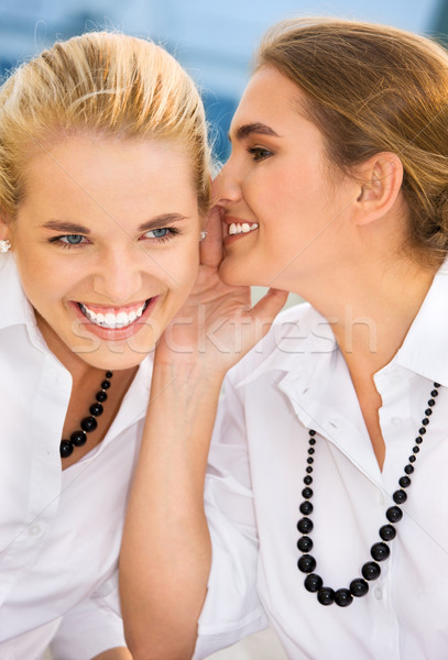 Secrets photos deux heureux jeunes Photo stock © dolgachov