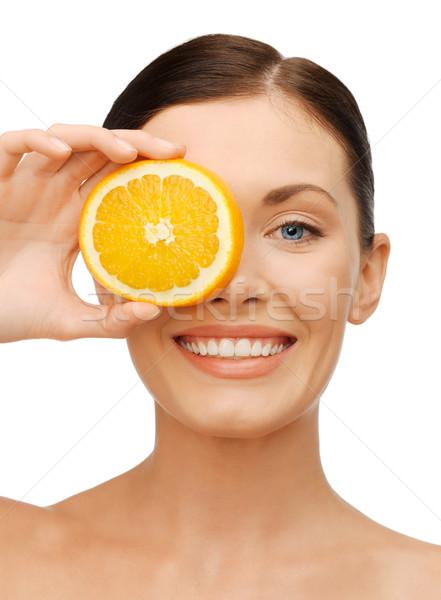 Mujer rodaja de naranja brillante Foto mujer hermosa feliz Foto stock © dolgachov