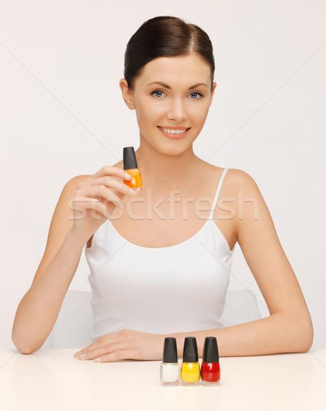 Mulher unha polonês garrafas quadro bela mulher feliz Foto stock © dolgachov