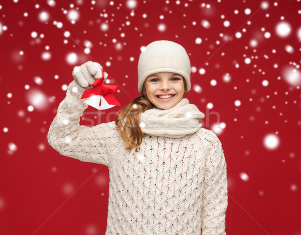 girl in hat, muffler and gloves with jingle bells Stock photo © dolgachov