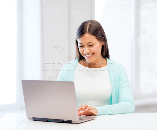 international student girl with laptop at school Stock photo © dolgachov
