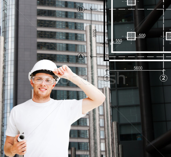 male architect in white helmet with blueprint Stock photo © dolgachov