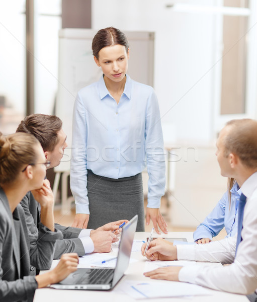 strict female boss talking to business team Stock photo © dolgachov