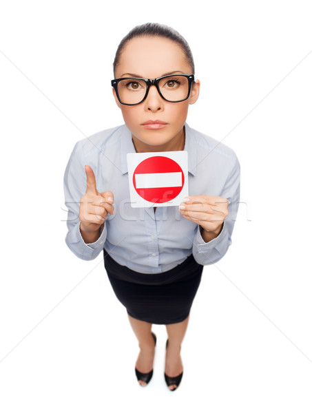 concerned businesswoman showing stop sign Stock photo © dolgachov