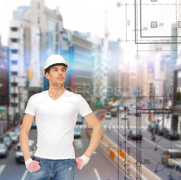 Przystojny budowniczy kask budynku rozwój architektury Zdjęcia stock © dolgachov