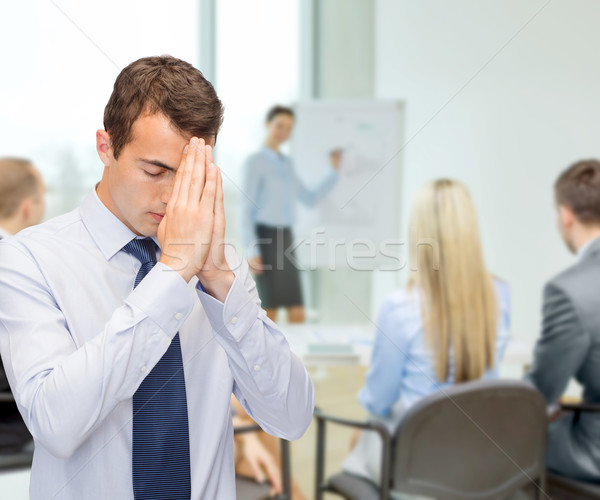 praying young buisnessman at office Stock photo © dolgachov