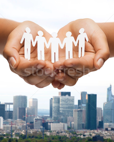 womans hands with paper team Stock photo © dolgachov