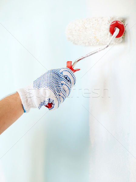 close up of male in gloves painting wall Stock photo © dolgachov