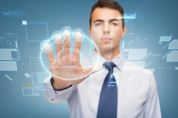 attractive buisnessman working with virtual sceen Stock photo © dolgachov