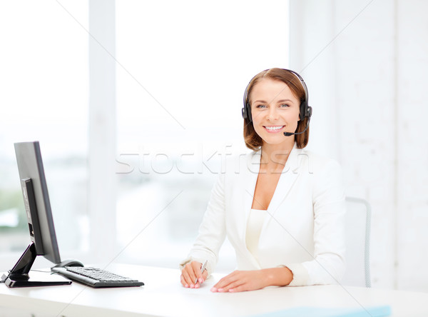 friendly female helpline operator with computer Stock photo © dolgachov