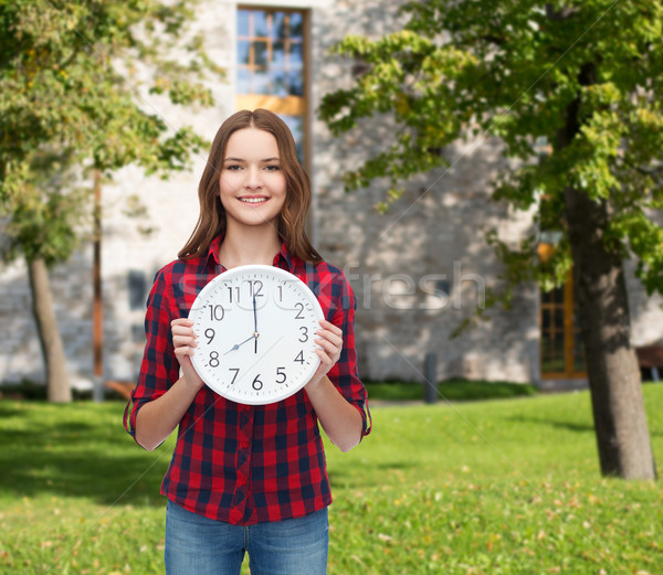 young woman in casual clothes with wall clock Stock photo © dolgachov