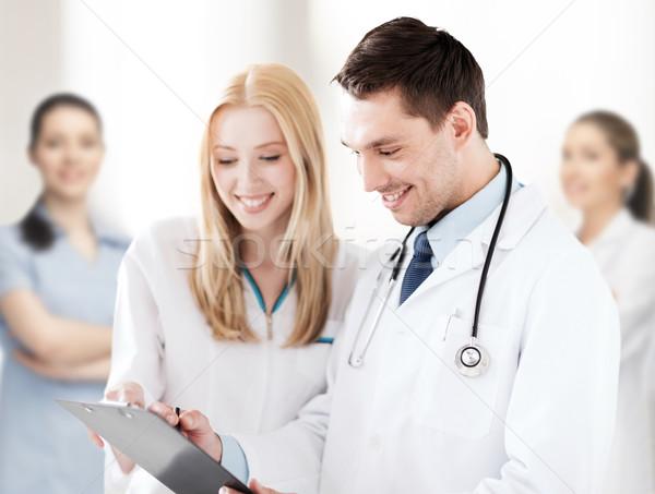 Due medici iscritto prescrizione sanitaria medici Foto d'archivio © dolgachov