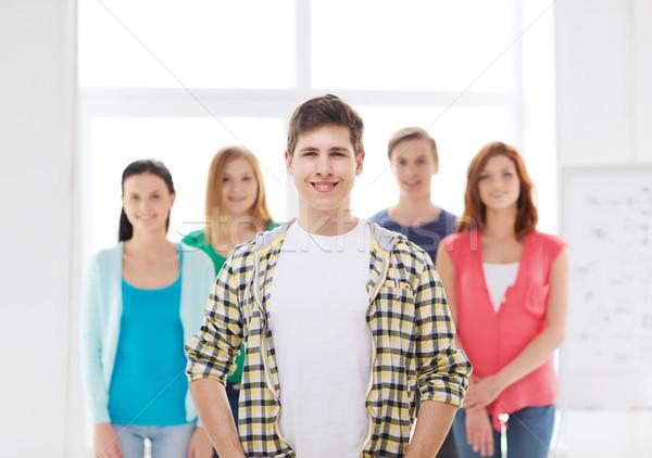 Souriant Homme étudiant groupe amitié Photo stock © dolgachov