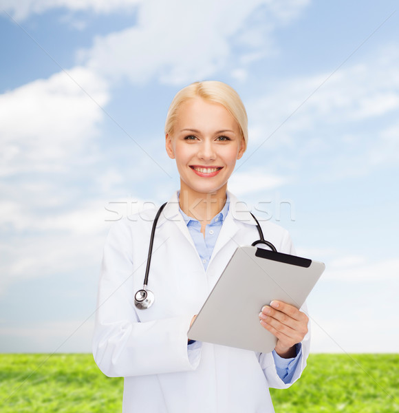 female doctor with stethoscope and tablet pc Stock photo © dolgachov