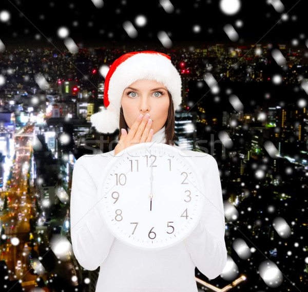 Mujer ayudante sombrero reloj Foto stock © dolgachov