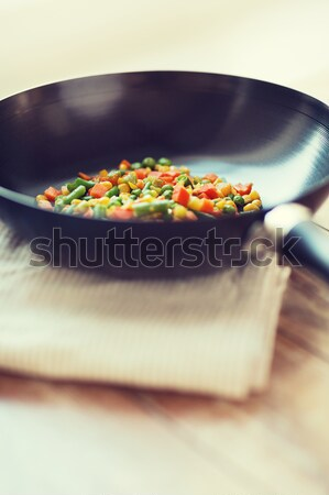 close up of wok pan with vegetables Stock photo © dolgachov