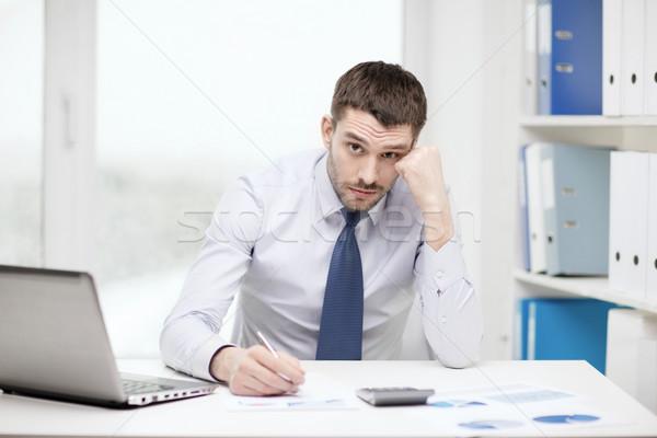 Empresário laptop documentos escritório negócio Foto stock © dolgachov