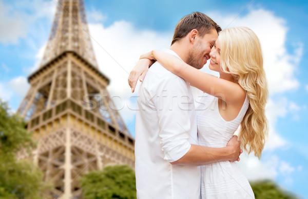 happy couple hugging over eiffel tower Stock photo © dolgachov