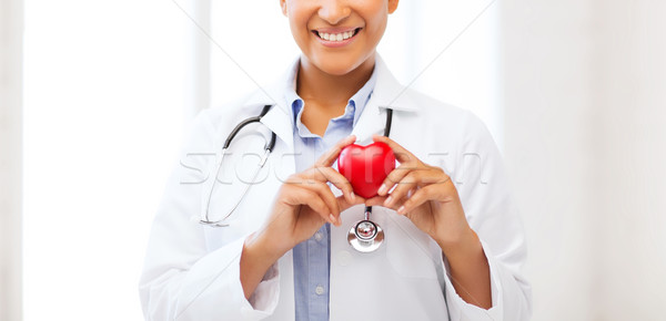 african doctor with heart Stock photo © dolgachov