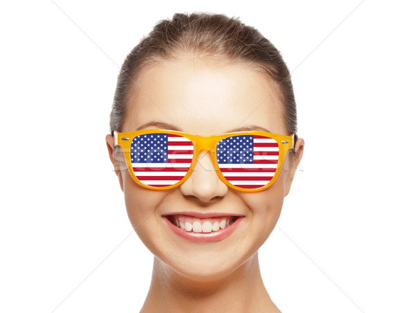 happy teenage girl in shades with american flag Stock photo © dolgachov